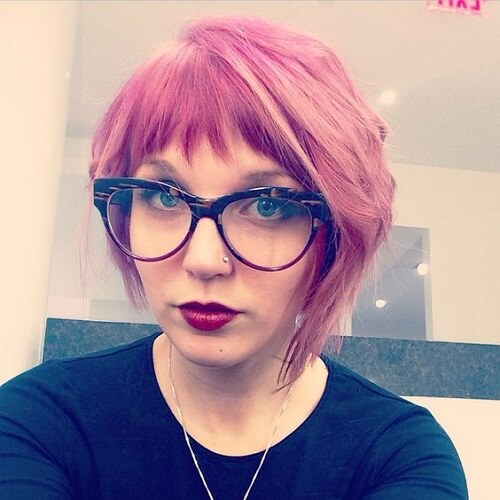 pink asymmetrical haircut with choppy bangs