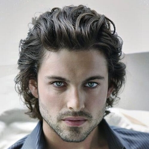 combed back curly hairstyle for men