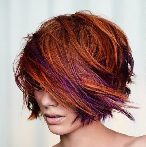 short bob with orange and purple highlights