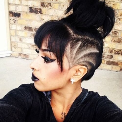 messy bun with bangs and shaved side