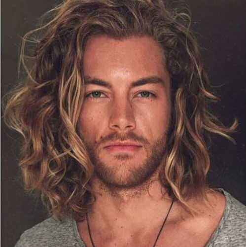 man with surfer hairstyle