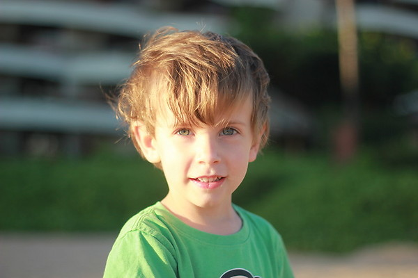 little boy with messy hair