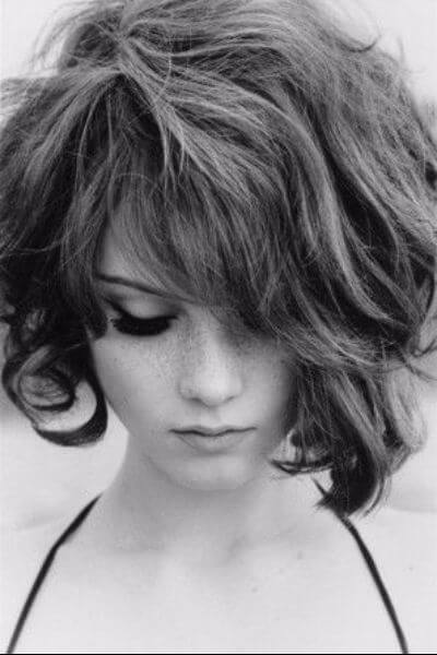 Asymmetrical Angled Bob for Thick Wavy Hair