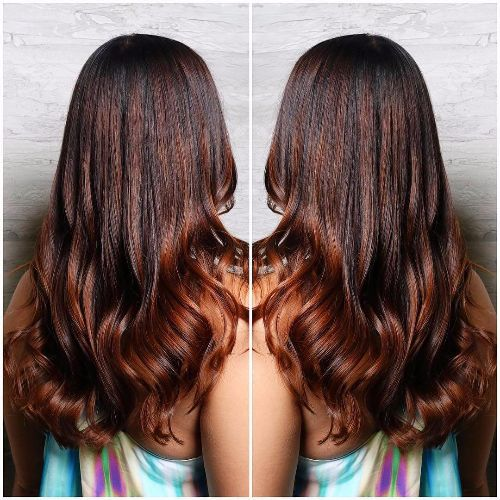 Chestnut brown hair with red highlights
