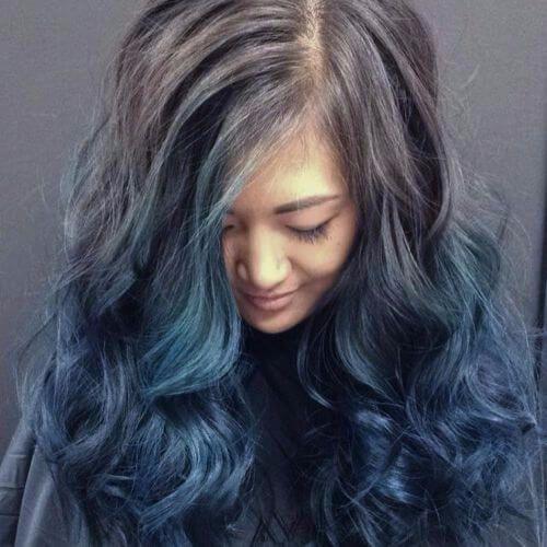 blue balayage highlights on dark hair