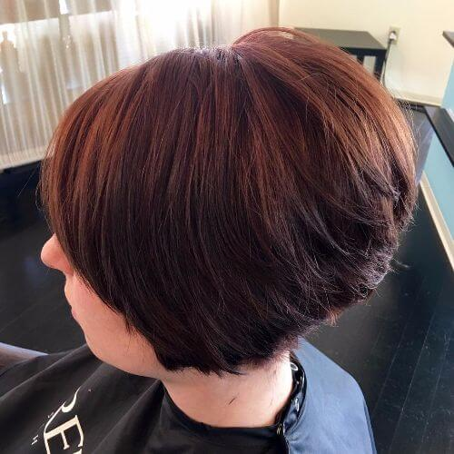 stacked bob haircut on burgundy hair