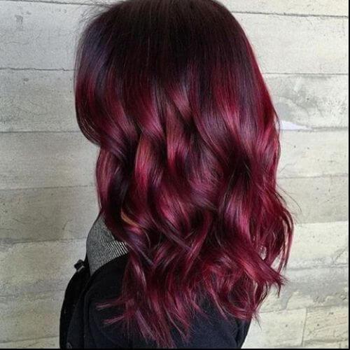 burgundy balayage on wavy hair