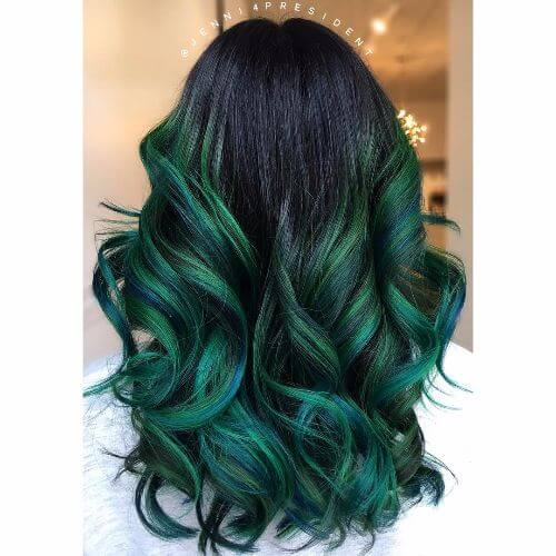 wavy green balayage highlights on long hair