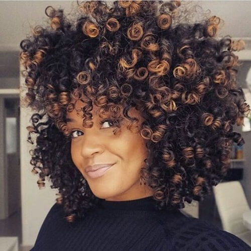 natural afro hair with copper balayage