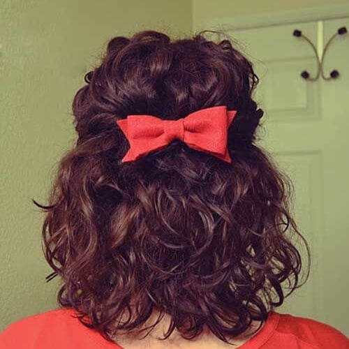 short curly hair with red bow