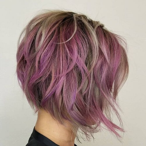 short asymmetrical haircut with purple and grey colors