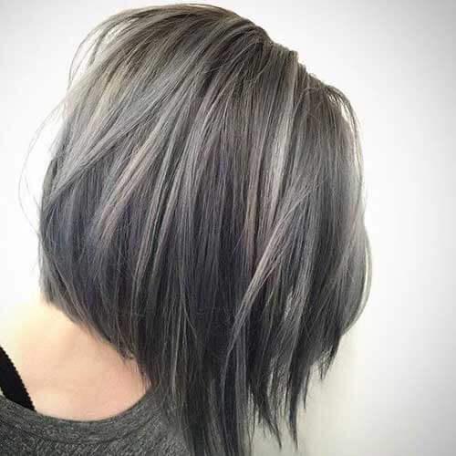 asymmetrical bob with steel grey hair color