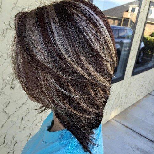 dark brown hair with blonde highlights