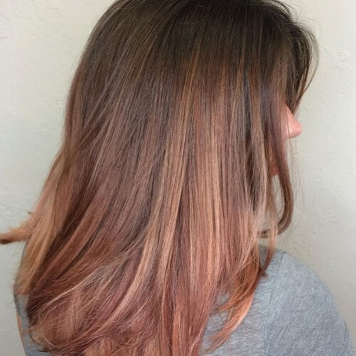 dark brown hair with strawberry blonde highlights