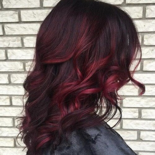dark brown hair with light brown and red highlights