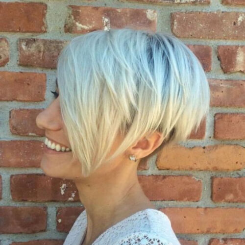 Bleach Blonde Pixie cut with long bangs