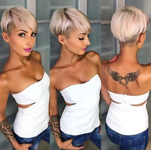 lemonade blonde pixie cut with long bangs