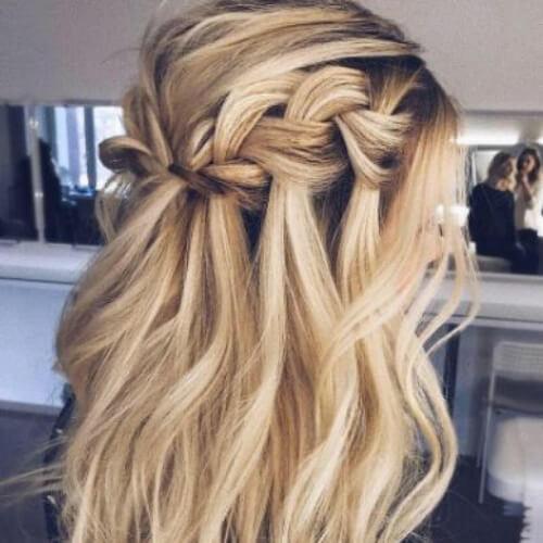 Voluminous waterfall braid with curls