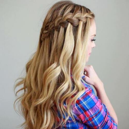 honey blonde waterfall braid with curls