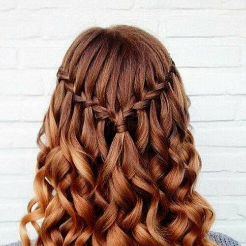 redhead waterfall braid with curls