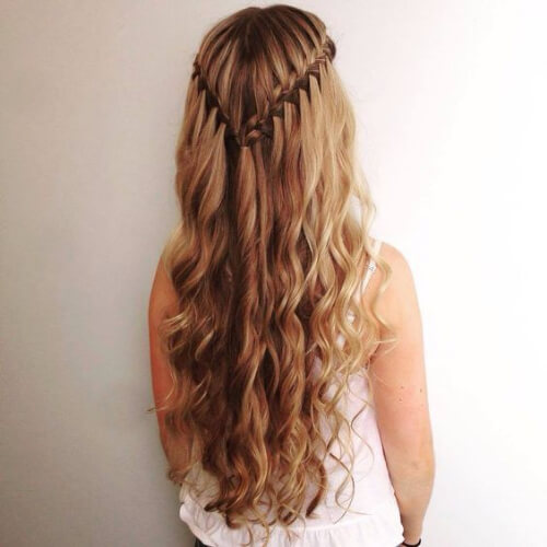 romantic waterfall braid with curls