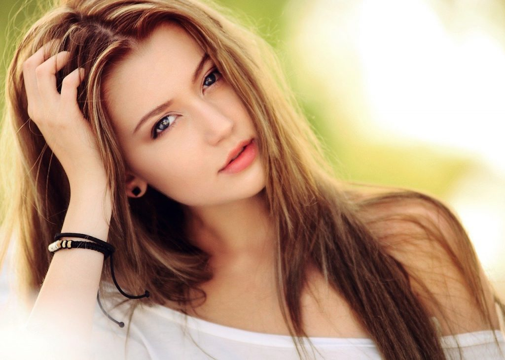 A woman with light brown hair from madison reed hair dye