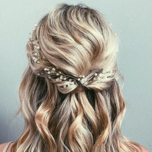 decorated half up hairstyles for wedding guest