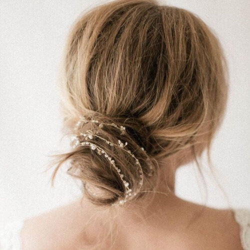 decorated messy bun hairstyles for wedding guest