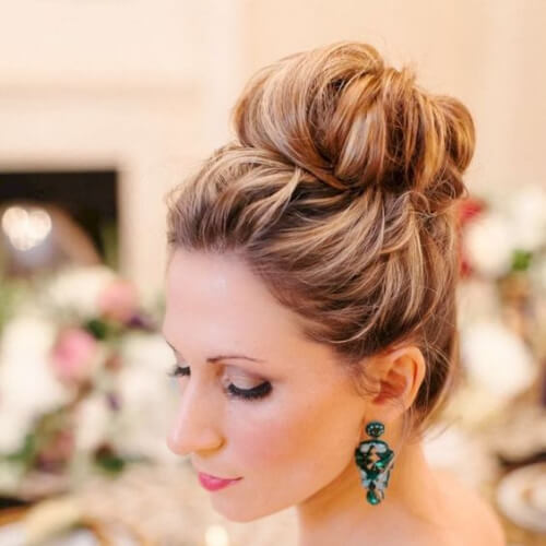 top bun hairstyles for wedding guest
