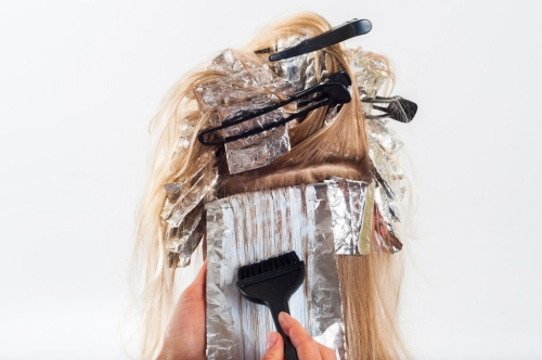 hair being dyed with aluminum foils