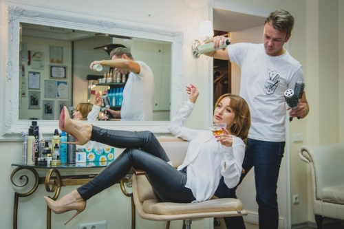woman drinking wine while man pampers hair