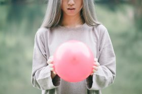 girl with silver hair and pink balloon